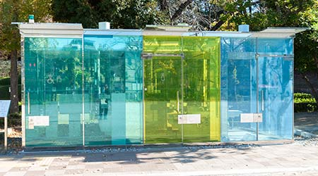 Shibuya, Tokyo, Japan - November 23, 2020: Transparent public toilet located at Haru-No-Ogawa Community Park.