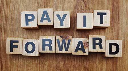 """""""Pay it forward"""" written out in blocks"""