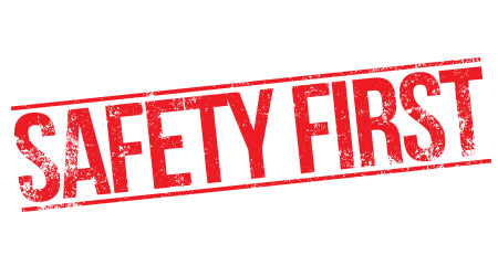 """A red stamp mark that reads """"Safety First"""""""
