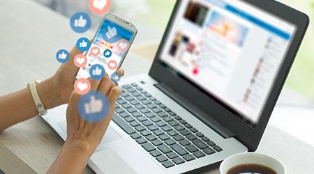 Young woman using a smart phone. Social media concept.