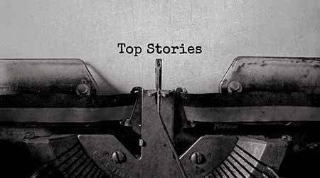 """""""top stories"""" written out on a vintage typewriter"""