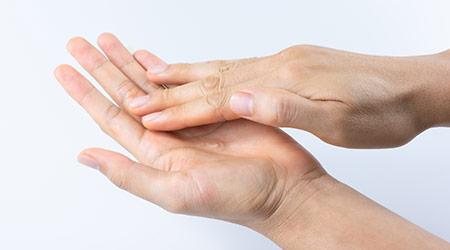 Man rubbing his hands