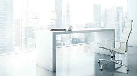 clean white office with desk and chair in front of window