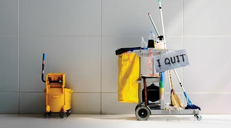 "Picture of janitor's cart of tools with an ""I Quit"" sign showing"