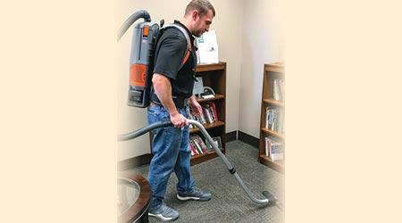 Man using battery-powered backpack vacuum