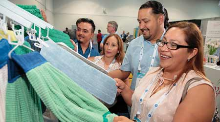 facility cleaning managers looking at microfiber string mops at Clean Buildings Expo