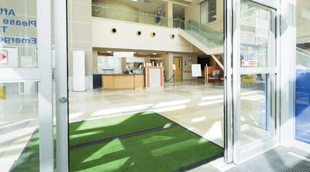 green floor mats inside facility entrance doors