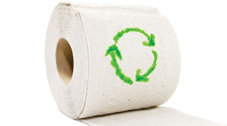 toilet paper roll with green recycling symbol