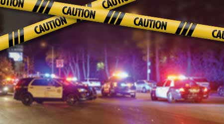 facility emergency with police cars and caution tape