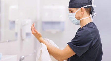 doctor washing hands with soap in hospital