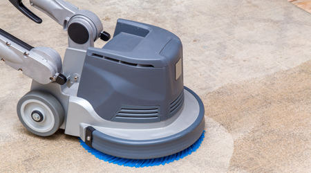 floor equipment with spinning floor pad used to clean carpeting