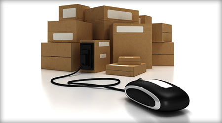 Computer mouse attached to several boxes by its wire