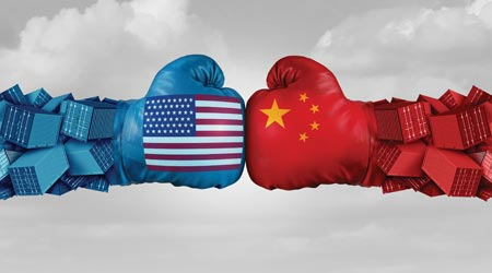 Boxing gloves with Chinese and American flags on them