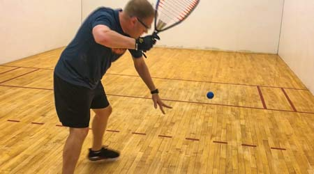 Man plays racquetball