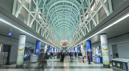 Travelers hurry about in Terminal 3 of Chicago's O'Hare international airport