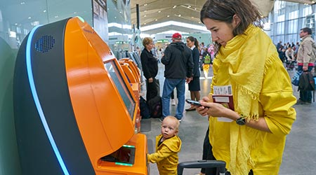woman use self check-in kiosk in Airport