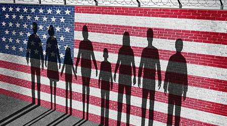 American immigration and United States refugee crisis concept as people on a border wall with a US flag as a social issue on refugees or illegal immigrants with the shadow of a group of migrants