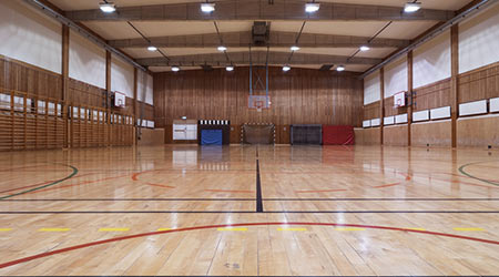 Interior of an old school gym with shiny wood floors