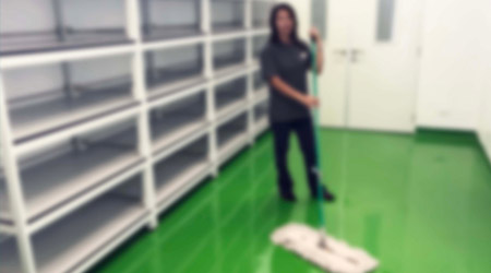 Women janitor mopping floor interior of new building blur image use for background