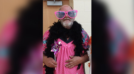 Bob Cook happily stepped out on stage in a tutu and wig