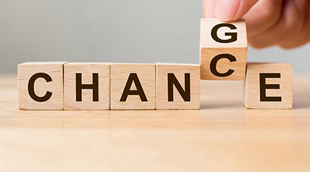 Hand flip wooden cube with word change to chance, Personal development and career growth or change yourself