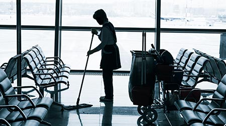 Worker cleaning the floor in the airport