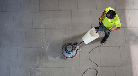 The man cleaning floor with machine