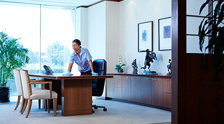 Woman cleaning office desk
