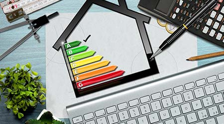 Energy efficiency rating graph on a desk with a house model