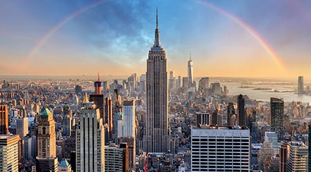 New York City skyline with urban skyscrapers and rainbow