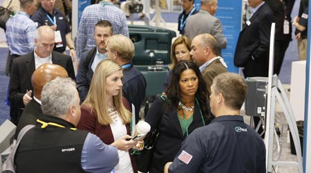 Group of people talking about products at a trade show