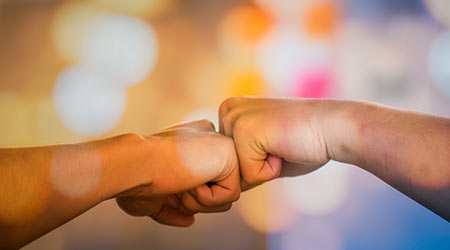 Team Business Partners Giving Fist Bump to Greeting