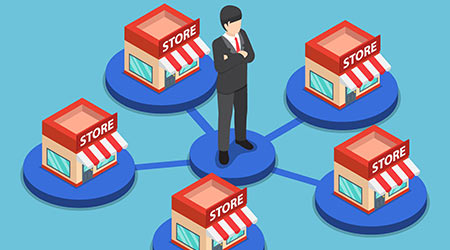 businessman standing with shopping store network