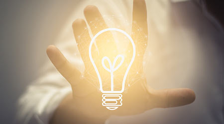 Business idea and vision, businessman holding light bulb, concept of new ideas, innovation, invention and creativity