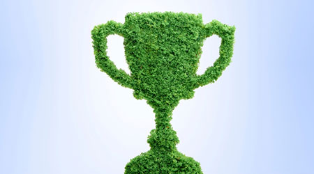 Grass growing in the shape of a trophy cup