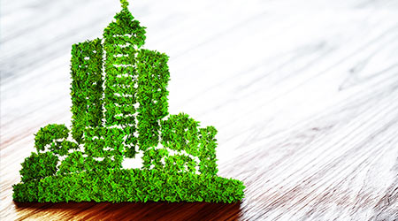 Green ecology city development icon on wooden background