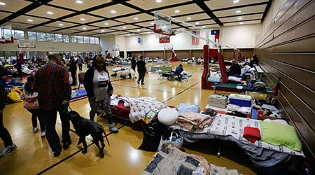 Cleanup Crews Work To Curb Illness At Wildfire Evacuee Shelters