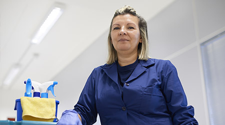 Women at work, portrait of happy professional female cleaner smiling and looking at camera in office
