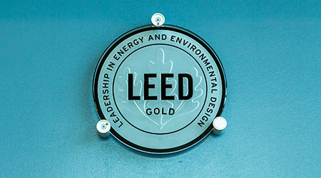 LEED (Leadership in Energy and Environmental Design) Gold level certification sign inside building