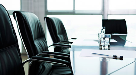black chairs and white paper with pen in the meeting room