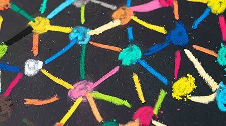 macro view of colorful pastel link and connect chalk line between multiple dot or teer on blackboard