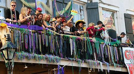 People celebrated Mardi Gras parade in French Quarter in New Orleans, Louisiana