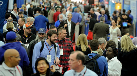 trade show floor bustling with attendees