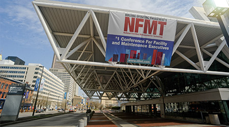 sign saying NFMT hanging on exterior of convention center