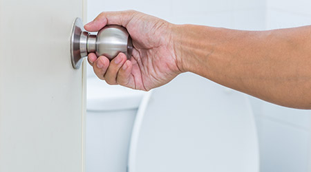 Man hand open toilet door
