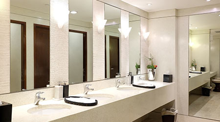 Faucets with washbasin in public restroom ,Contemporary interior of public toilet