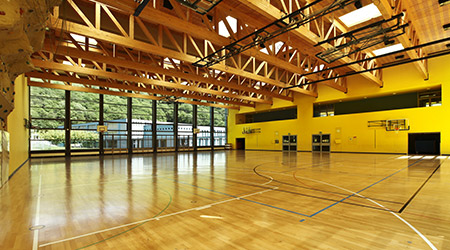 public school, interior wide gym with wood floor