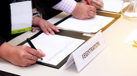 close-up of registration desk in front of conference center
