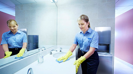 Woman cleaning restroom