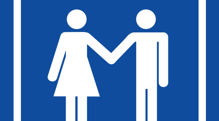 universal restroom sign showing a man and a woman holding hands in partnership